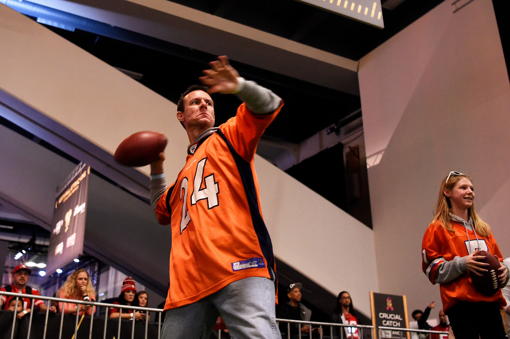 . SAN FRANCISCO, CA - FEBRUARY 05: Chad Kosmicki concentrates as he sets up his throw in the Critical Catch game as his daughter, 13 year old Hannah waits for her turn at the NFL Experience in downtown San Francisco, CA. February 05, 2016 (Photo by Joe Amon/The Denver Post)
