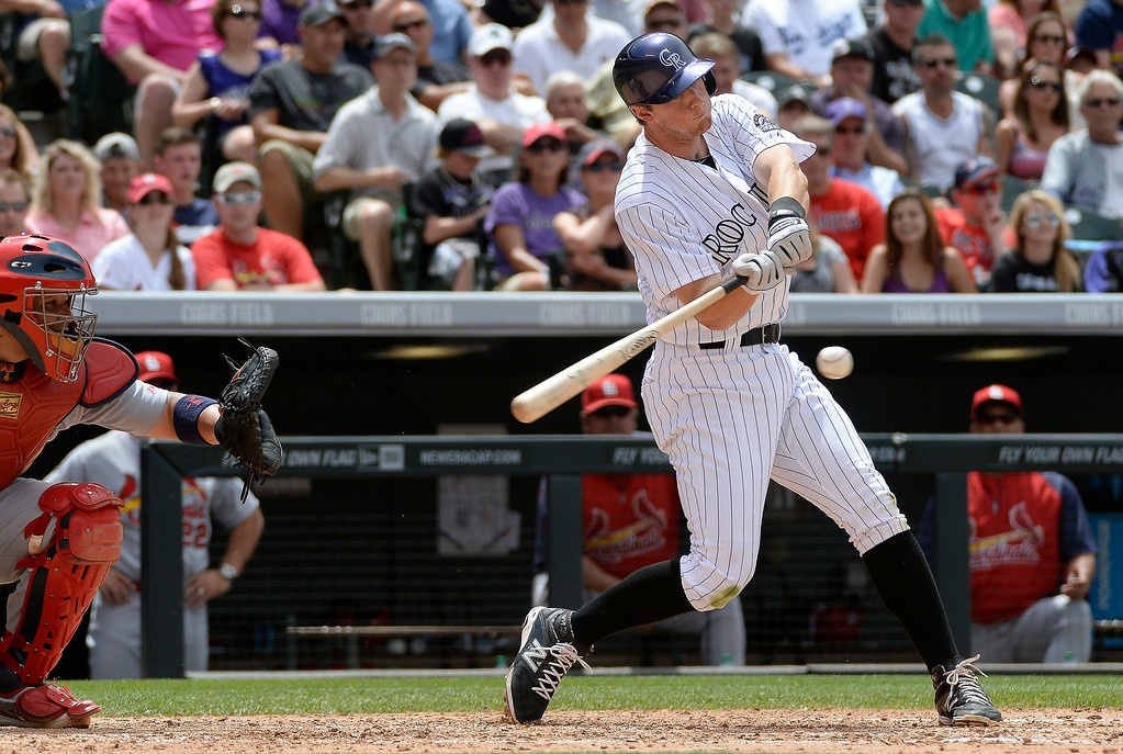 . Colorado Rockies second baseman DJ LeMahieu (9) hits a RBI single to score Colorado Rockies left fielder Corey Dickerson (6) off of St. Louis Cardinals starting pitcher Marco Gonzales (56) during the fourth inning June 25, 2014 at Coors Field. (Photo by John Leyba/The Denver Post)