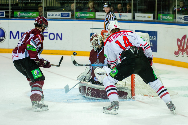 Vaclav Nedorost (14) and Jekabs Redlihs (14) play in front of the Dinamo Riga goal