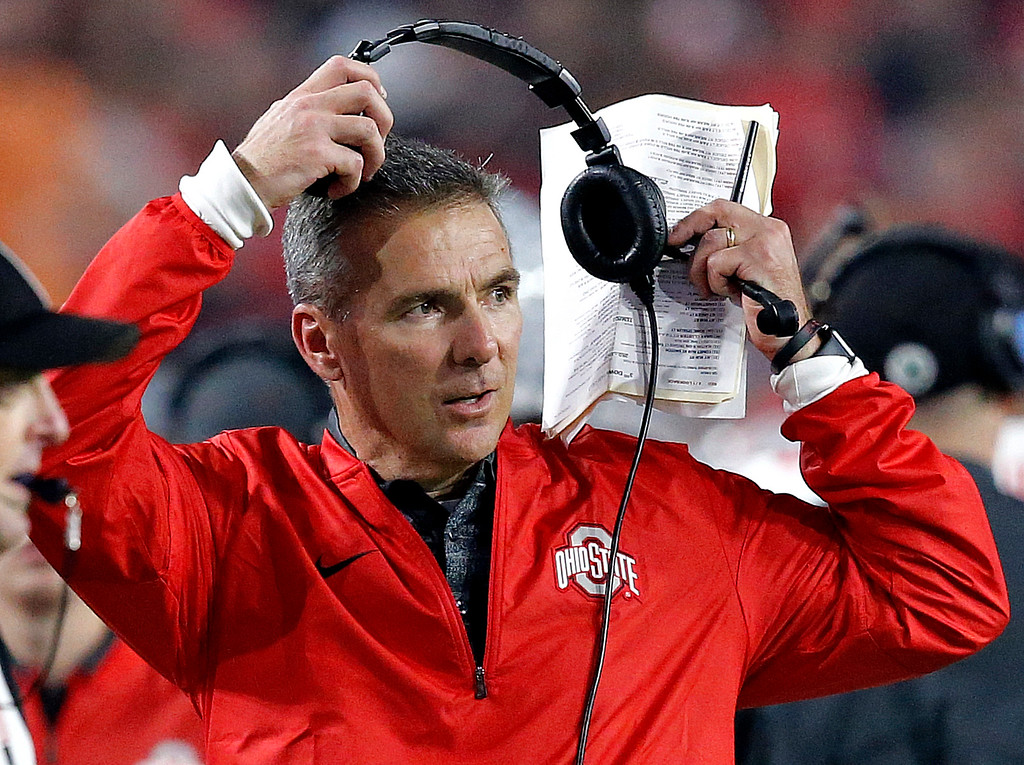 . Ohio State head coach Urban Meyer takes off his headset during the second half of the Fiesta Bowl NCAA college football game against Clemson, Saturday, Dec. 31, 2016, in Glendale, Ariz. (AP Photo/Ross D. Franklin)