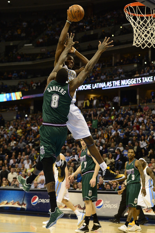 . DENVER, CO - FEBRUARY 5: Kenneth Faried Denver Nuggets (35) gets fouled by Larry Sanders Milwaukee Bucks (8) during the second half of action. The Denver Nuggets defeat the Milwaukee Bucks 112-104 in NBA action at the Pepsi Center. (Photo By AAron Ontiveroz/The Denver Post)