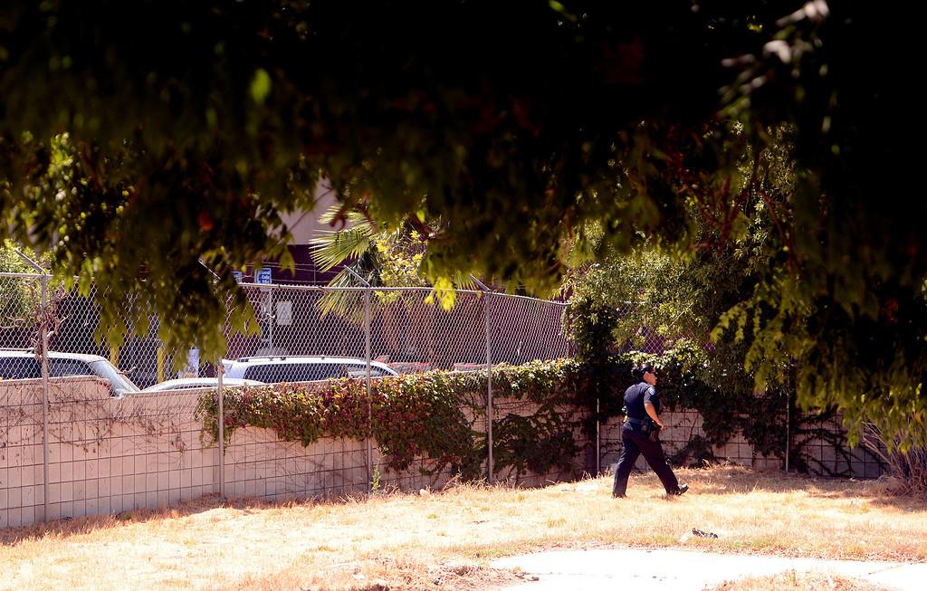 . San Bernardino Police Officer and Homeless Advocate Sochilt Martinez looks for homeless camps in a vacant lot along Ninth Street in San Bernardino August 14, 2013. GABREL LUIS ACOSTA/STAFF PHOTOGRAPHER.
