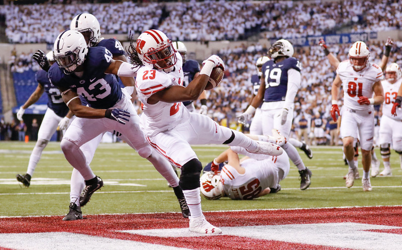 Wisconsin Badgers running back Dare Ogunbowale (23) scores a touchdown during the first half of the Wisconsin Badgers against the Penn State Nittnay Lions for the Big Ten football championship at Lucas Oil Stadium in Indianapolis, Ind., Saturday, Dec. 3, 2016. (Photo by Sam Riche)