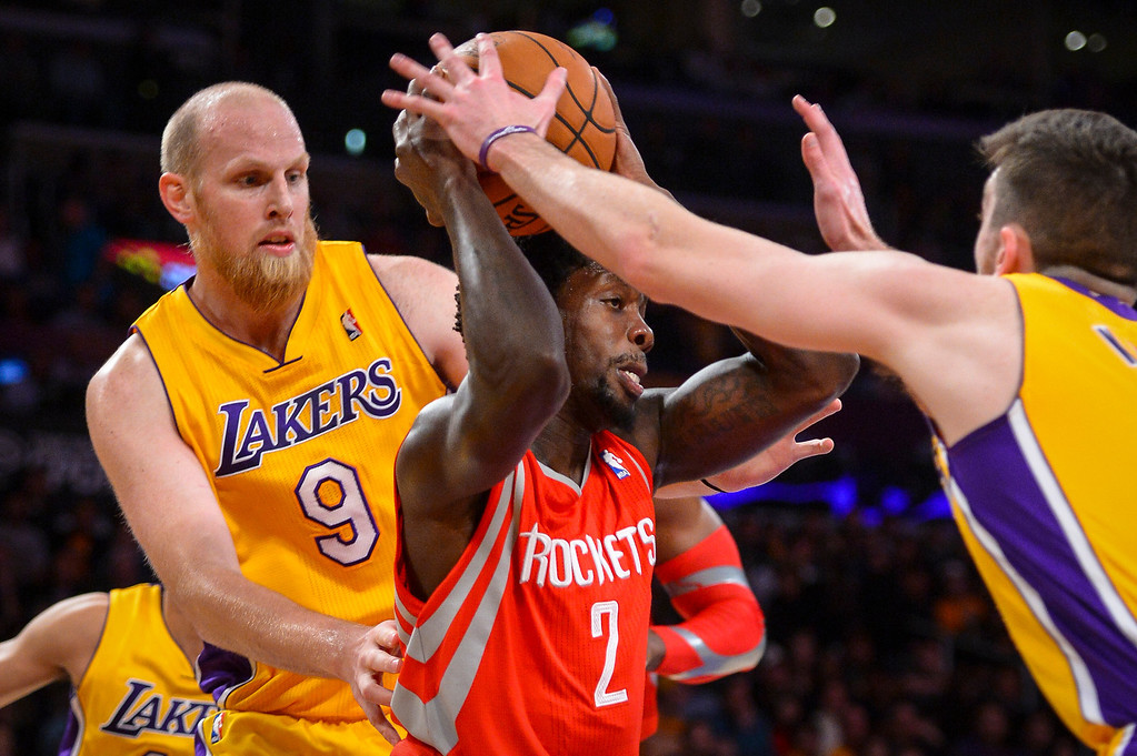 . Lakers� Chris Kaman and Ryan Kelly trap rockets� Patrick Beverley during first half action at Staples Center Wednesday, February 19, 2014. ( Photo by David Crane/Los Angeles Daily News )