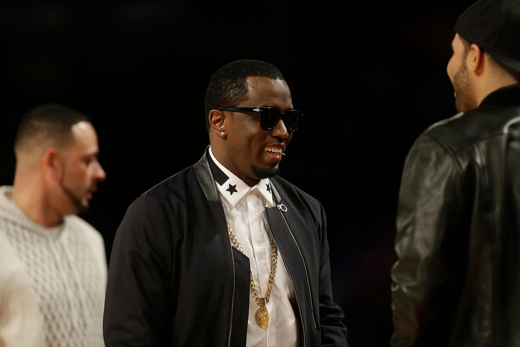 . Rapper P Diddy greets fans during the NBA All Star basketball game, Sunday, Feb. 16, 2014, in New Orleans. (AP Photo/Gerald Herbert)