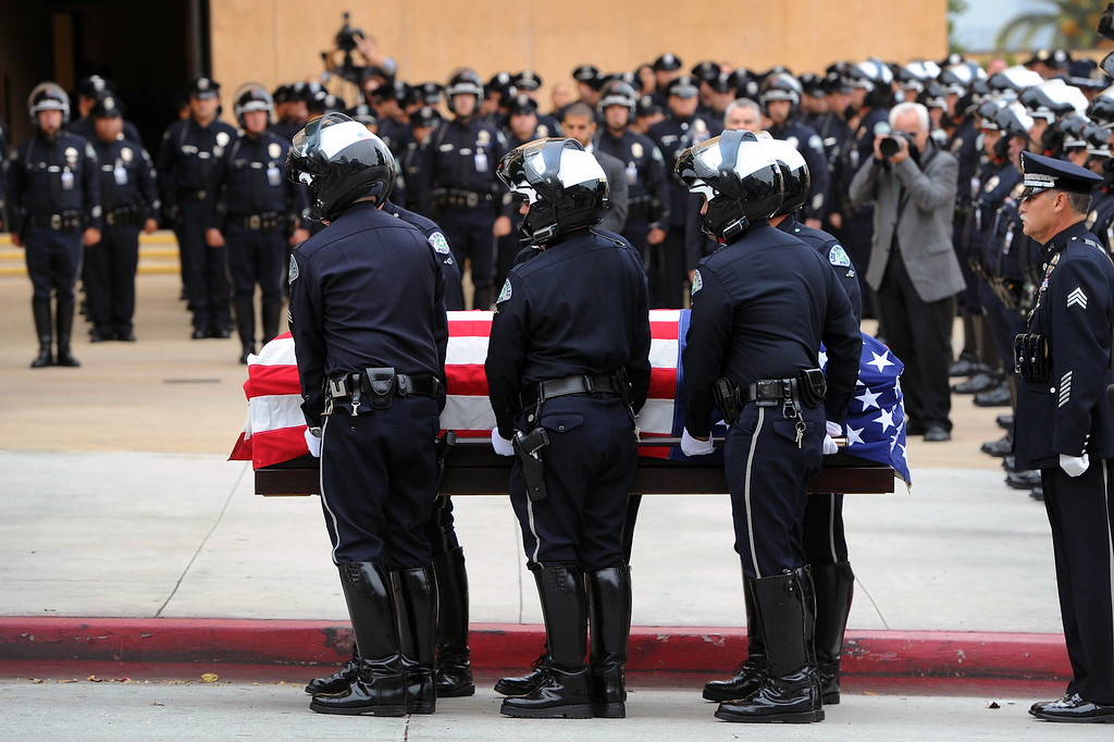 . Honorary pallbearers carry the casket of LAPD motorcycle officer Chris Cortijo at Cathedral of Our Lady of the Angels, Tuesday, April 22, 2014, for the funeral mass. (Photo by Michael Owen Baker/L.A. Daily News)