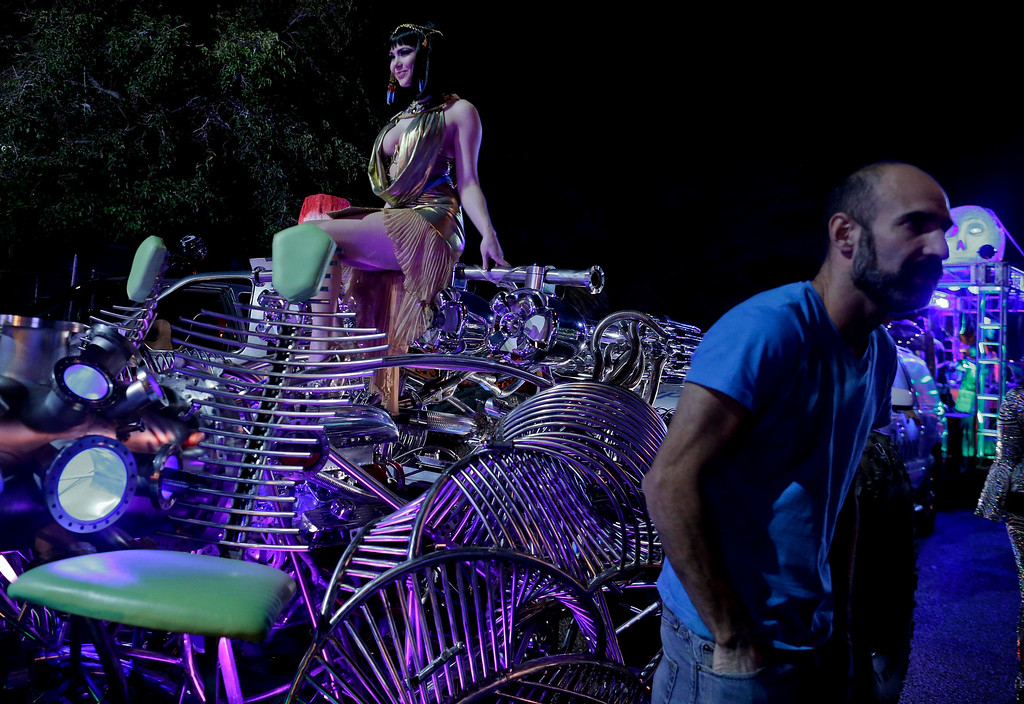 . Preparing to ride in the fourth annual Las Vegas Halloween Parade, parade queen Claire St. Claire positions herself atop a futuristic car in the procession on Thursday, Oct. 31, 2013, in Las Vegas. (AP Photo/Julie Jacobson)