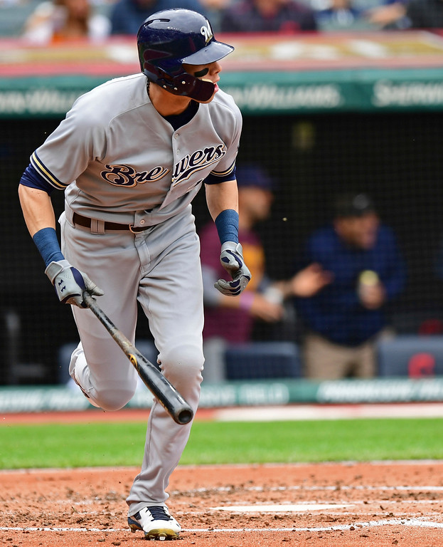 . Milwaukee Brewers\' Christian Yelich watches a double off Cleveland Indians starting pitcher Carlos Carrasco in the third inning of a baseball game, Wednesday, June 6, 2018, in Cleveland. (AP Photo/David Dermer)
