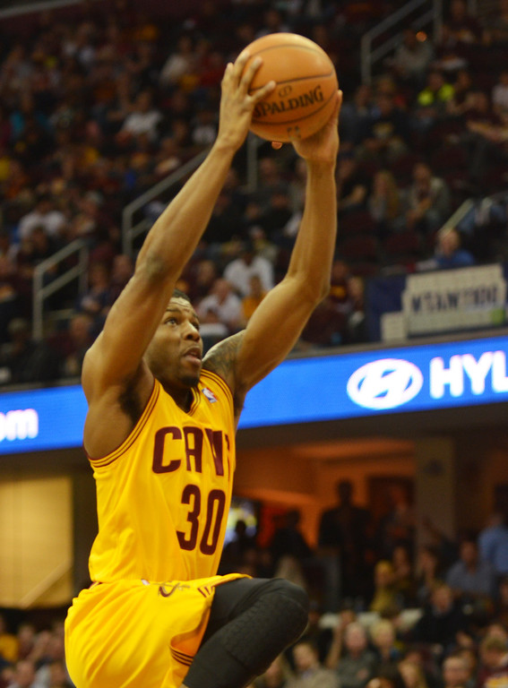 . Michael Allen Blair/Digital First Media Cavs\' forward Carrick Felix goes up for a dunk during the fourth quarter of a game April 16 at Quicken Loans Arena.