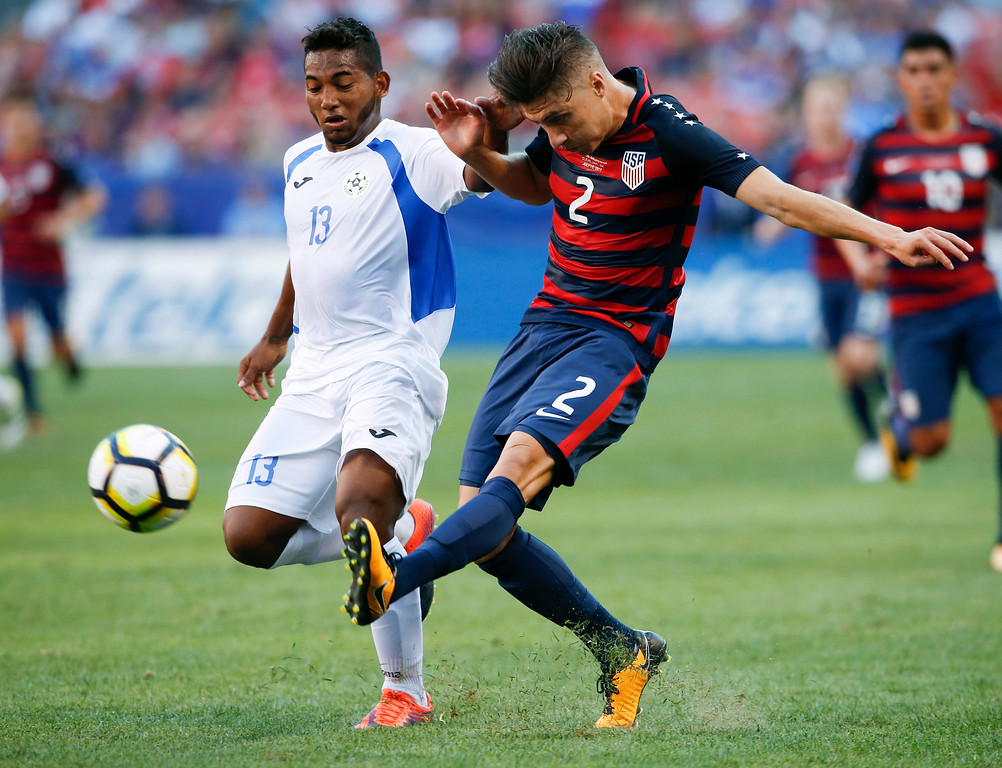 . United States\' Jorge Villafana (2) passes against Nicaragua\'s Bryan Garcia (13) during a CONCACAF Gold Cup soccer match in Cleveland, Saturday, July 15, 2017. (AP Photo/Ron Schwane)