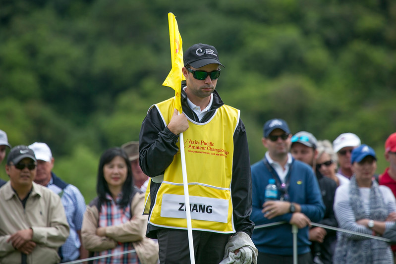 Andy Zhang's caddy Ben Slaven on the 6th green on the final Day of the Asia-Pacific Amateur Championship tournament 2017 held at Royal Wellington Golf Club, in Heretaunga, Upper Hutt, New Zealand from 26 - 29 October 2017. Copyright John Mathews 2017.   www.megasportmedia.co.nz