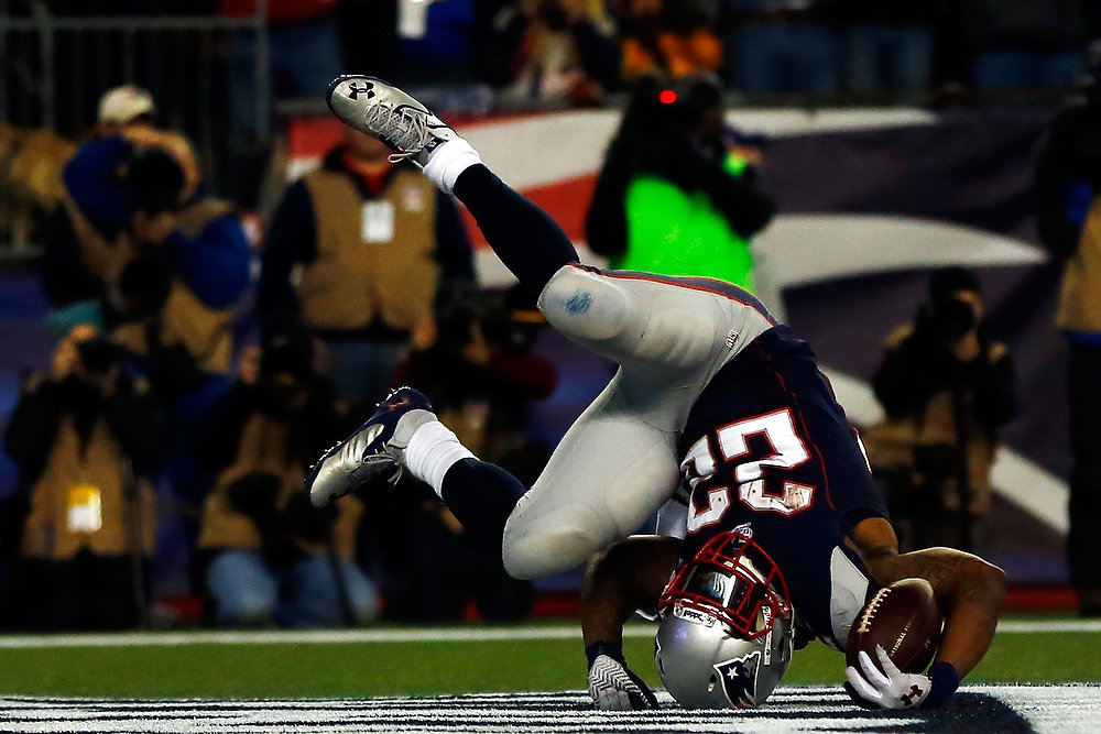 Description of . Stevan Ridley #22 of the New England Patriots scores a touchdown in the third quarter against the Houston Texans during the 2013 AFC Divisional Playoffs game at Gillette Stadium on January 13, 2013 in Foxboro, Massachusetts.  (Photo by Jared Wickerham/Getty Images)