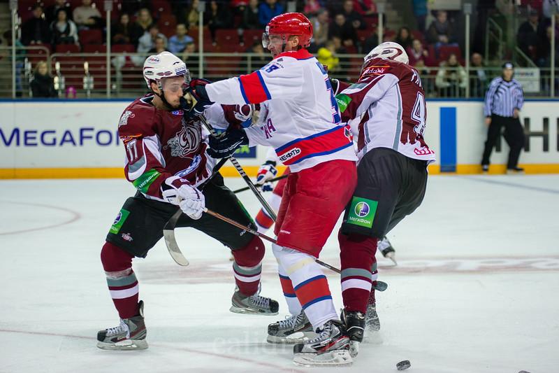 Kozlov Viktor (38) hits Martins Porejs (77) in face during the game