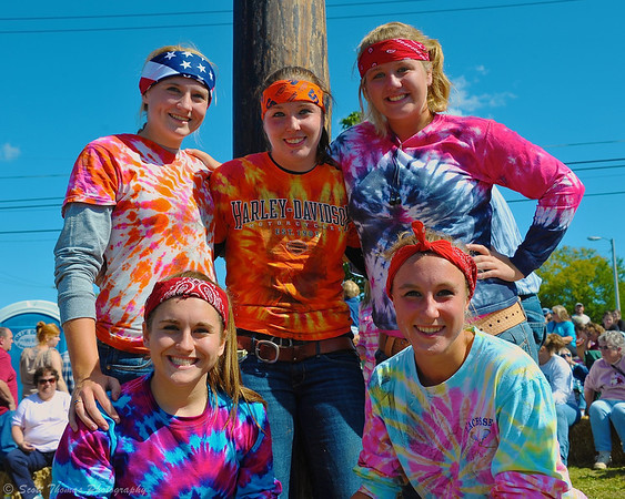 Colorful climbing team for the Adult Greased Pole Climb at the Jordan Fall Festival in Jordan, New York.