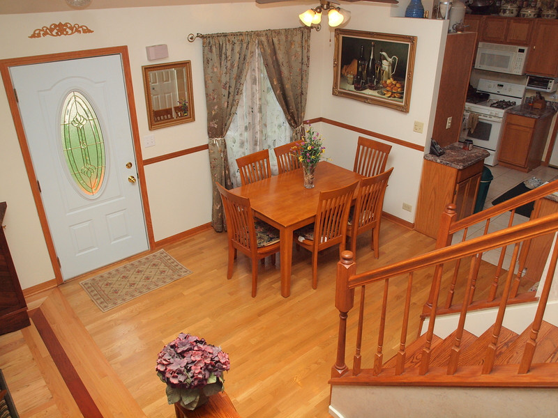 Open dining room with cathedral ceilings & hardwood floors!