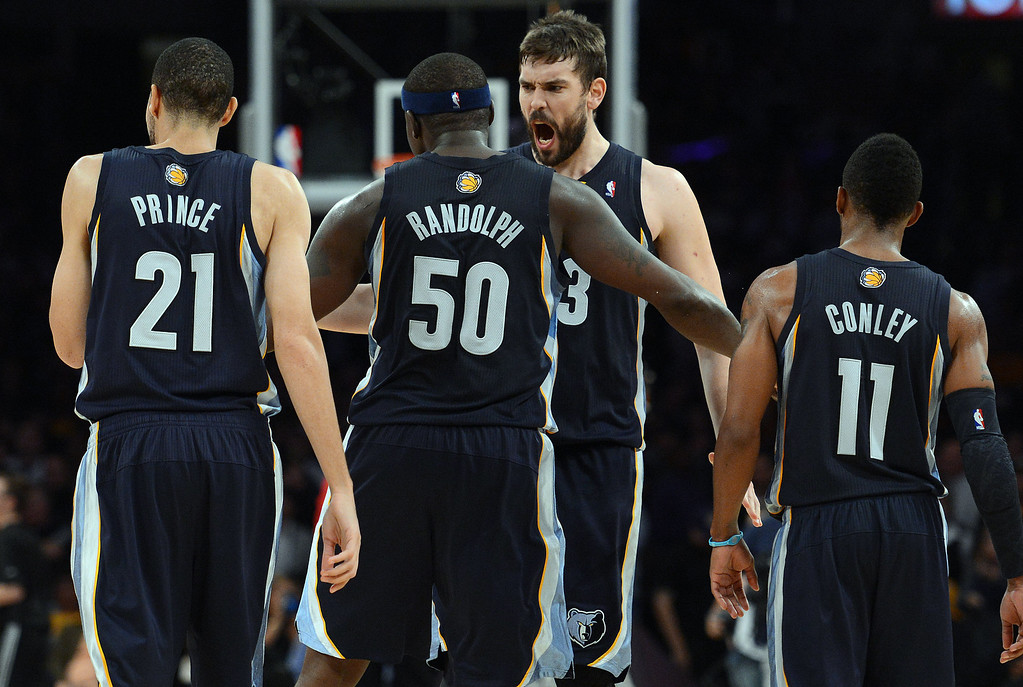 . The Grizzlies� Marc Gasol #33 bumps chests with Zach Randolph #50 after Randolph hit a shot during their game against the Lakers at the Staples Center in Los Angeles Friday, November 15, 2013. (Photo by Hans Gutknecht/Los Angeles Daily News)