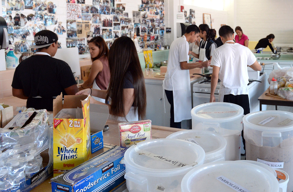 . El Rancho High School\'s culinary arts and hospitality class prepare food for the homeless on Wednesday November 27, 2013. The students and volunteers will deliver the food and clothing items in downtown Los Angeles on Thanksgiving. (Whittier Daily News/Staff Photo by Keith Durflinger)