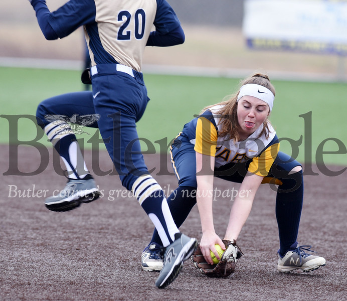 Harold Aughton/Butler Eagle: Mars second baseman, Julia Maple, fields a ball during last night's game against Knoch.