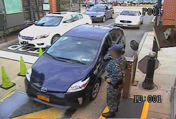 . In this handout frame grab from the Washington Navy Yard provided by the FBI on September 25, 2013, Aaron Alexis drives his rental car, a blue Toyota Prius, through the Washington Navy Yard main gate September 16, 2013 in Washington, DC.  (Photo by FBI via Getty Images)