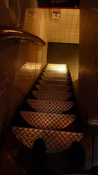 Scary stairs down to the restroom at the cafe.