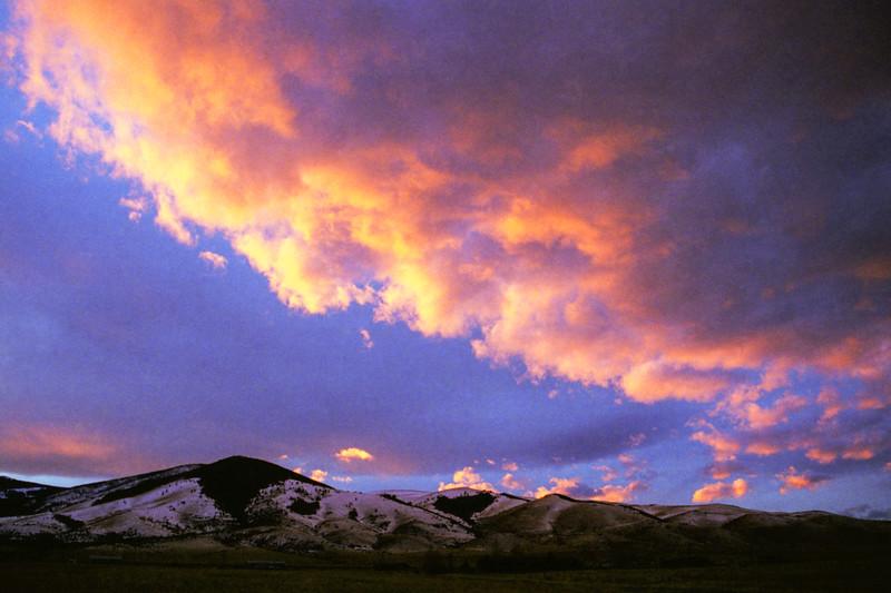 Sunset over the Elkhorns, sunrise over the Big Belts.  December 1998