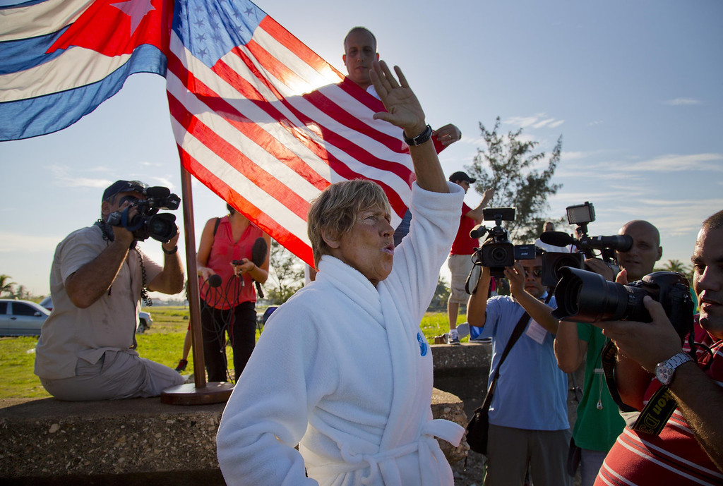. U.S. swimmer Diana Nyad, 64, salutes before her swim from Havana, Cuba, to Florida in Havana on Saturday, Aug. 31, 2013. Endurance athlete Nyad launched another bid Saturday to set an open-water record by swimming from Havana to the Florida Keys without a protective shark cage.   (AP Photo/Ramon Espinosa)