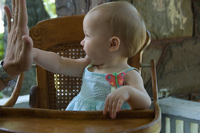 "Daddy says, ""Gimme five Thalia."""