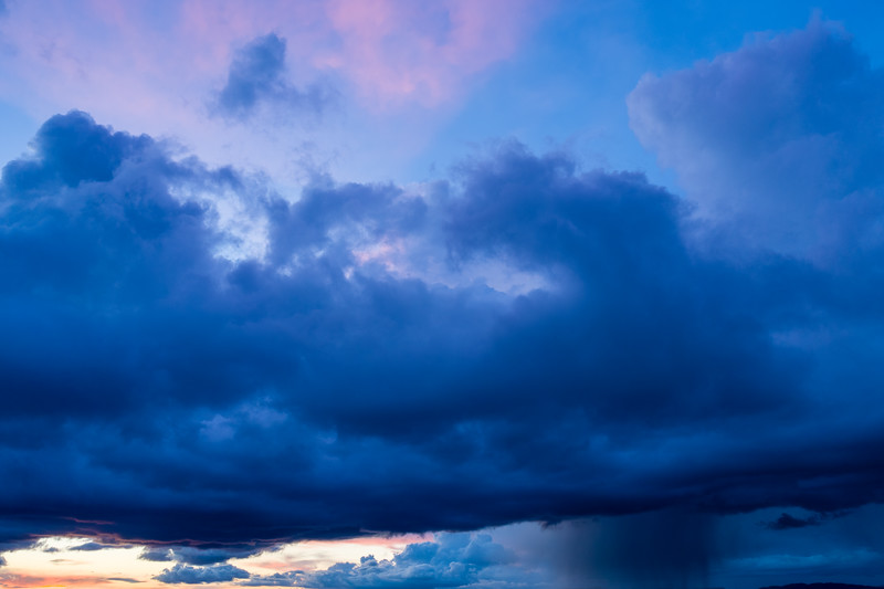 Blue storm clouds after sunset with a rain downpour in the San Fernando Valley, Los Angeles - Woodland Hills, Los Angeles, California, United States (US)