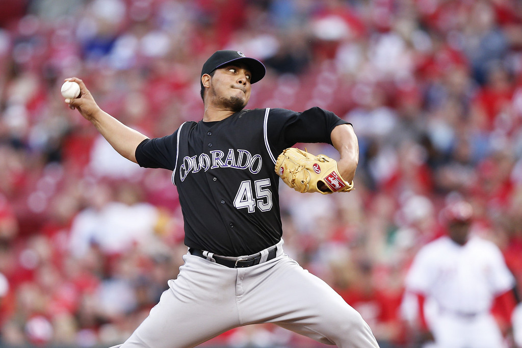 . CINCINNATI, OH - MAY 9: Jhoulys Chacin #45 of the Colorado Rockies pitches in the bottom of the third inning of the game against the Cincinnati Reds at Great American Ball Park on May 9, 2014 in Cincinnati, Ohio. (Photo by Joe Robbins/Getty Images)