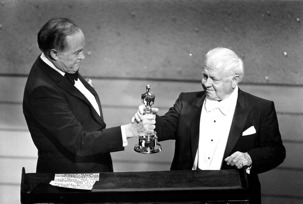 . Entertainer Bob Hope, left, presents the Honorary Oscar for Lifetime Achievement to actor Mickey Rooney at the 55th Annual Academy Awards ceremony in Los Angeles, Ca., April 10, 1983.  Rooney is honored for his 60 years of contribution to the motion picture industry.  (AP Photo)