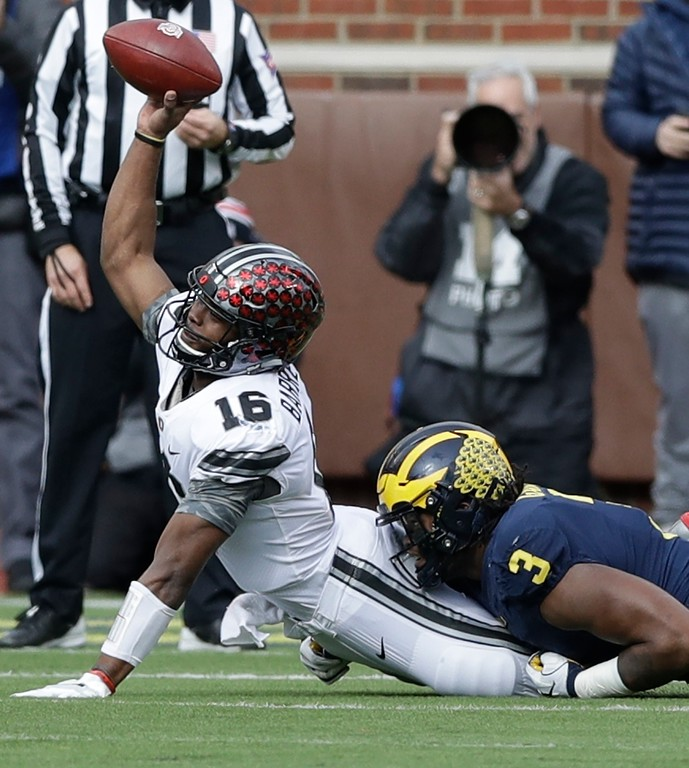 . Ohio State quarterback J.T. Barrett (16) is sacked by Michigan defensive lineman Rashan Gary (3) during the first half of an NCAA college football game, Saturday, Nov. 25, 2017, in Ann Arbor, Mich. (AP Photo/Carlos Osorio)