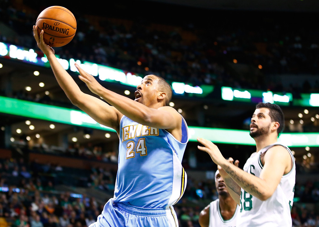 . BOSTON, MA - DECEMBER 06: Andre Miller #24 of the Denver Nuggets drives to the basket for a layup in front of Vitor Faverani #38 of the Boston Celtics in the second half during the game at TD Garden on December 6, 2013 in Boston, Massachusetts.  (Photo by Jared Wickerham/Getty Images)