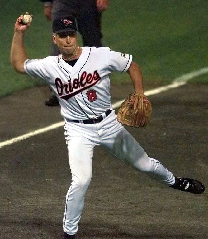 . The Baltimore Orioles\' Cal Ripken barehands a grounder from the Atlanta Braves\' Jeff Blauser for an out during the fifth inning of the All-Star Game Tuesday July 8, 1997, in Cleveland. Ripken made several key defensive plays in the early innings.  (AP Photo/Ed Reinke)