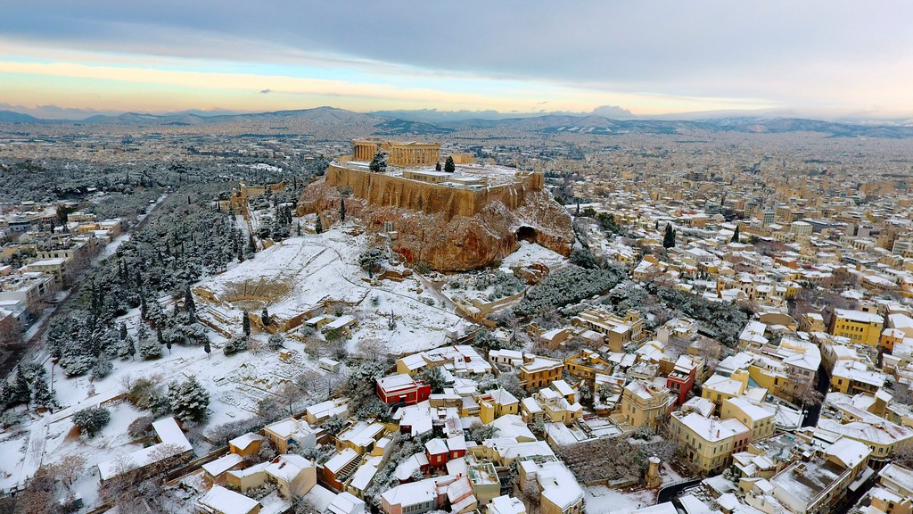 . The Parthenon temple is seen atop of the snow-covered Acropolis hill in Athens, on Tuesday, Jan. 10, 2017. Snow closed schools in the capital, as added pressure on the government to speed up winter preparations for thousands of refugees living in camps around the country. (Antonis Nikolopoulos/Eurokinissi via AP)