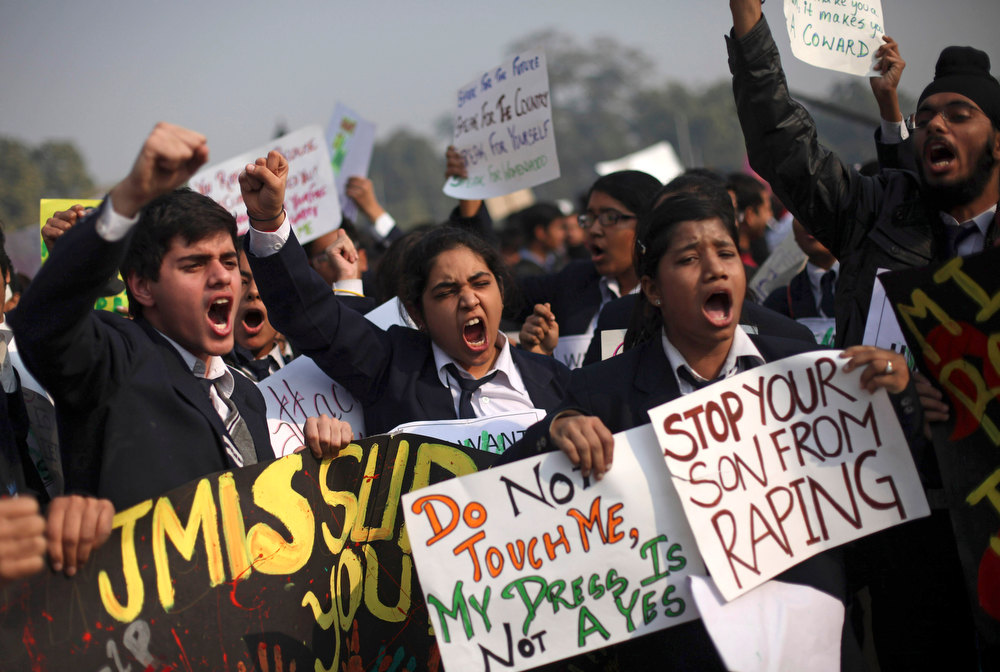 Description of . Indian schoolchildren hold placards and shout slogans during a protest against the Dec. 16 gang rape and beating of a young woman on a city bus in New Delhi, India, Saturday, Dec. 22, 2012. Police in Indiaís capital used tear gas and water cannons Saturday to push back thousands of people who tried to march to the presidential mansion to protest the recent gang rape and brutal beating of a 23-year-old student on a moving bus. (AP Photo/Altaf Qadri)