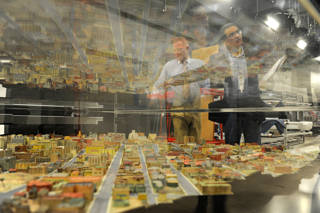 """. Simon Adlam, left, director of exhibits and creative director, and curator Bill Estrada, look at a 1939 WPA model of downtown Los Angeles on display at the \""""Becoming Los Angeles Exhibit\"""" which is set to open in July at the Natural History Museum of Los Angeles County. (Michael Owen Baker/Staff Photographer)"""