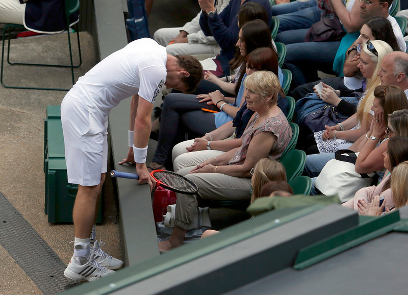 . Andy Murray of Britain leans on a wall after missing a shot  in his men\'s singles tennis match against Mikhail Youzhny of Russia at the Wimbledon Tennis Championships, in London July 1, 2013.             REUTERS/Eddie Keogh