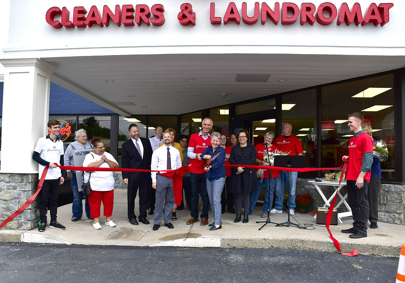9/28/2018 Mike Orazzi | Staff Dee Dee Mandino cuts the ribbon during the grand opening ceremony at Dee's Cleaners & Laundromat at 900 Farmington Avenue in Bristol Friday afternoon.