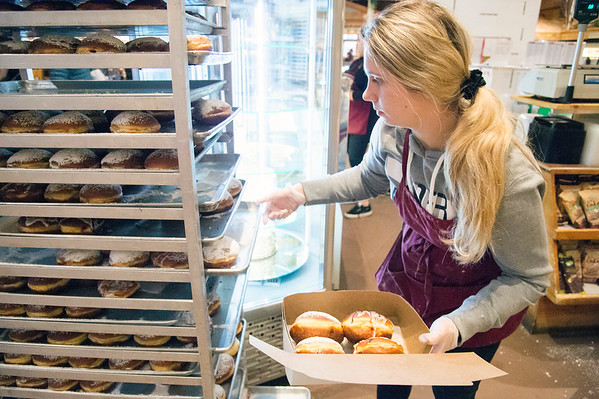 02/20/20 Wesley Bunnell | StaffrrAnna Czerkiewicz puts together a box of paczki for a customer as he stands in line at Roly Poly Bakery on Thursday February 20, 2020.