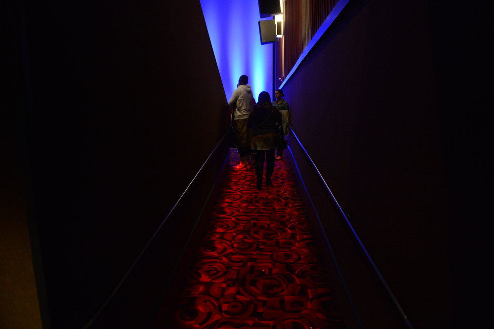 Description of . AURORA, CO. - JANUARY 17:  Guests arrive into theater XD before the reopening and remembrance of the Century Aurora Theater.  James Holmes is accused of killing 12 people and wounding 70 others on July 20, 2012 in theater 9. (Photo By RJ Sangosti / The Denver Post)