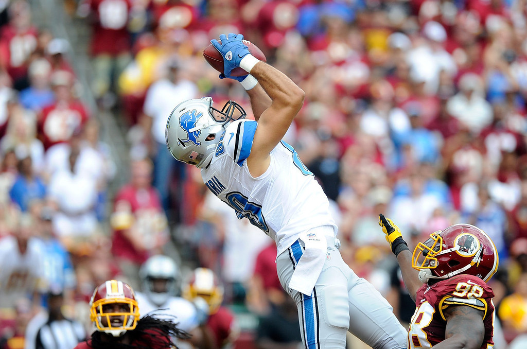 . Joseph Fauria #80 of the Detroit Lions scores a touchdown in the second quarter against the Washington Redskins at FedExField on September 22, 2013 in Landover, Maryland.  (Photo by Greg Fiume/Getty Images)