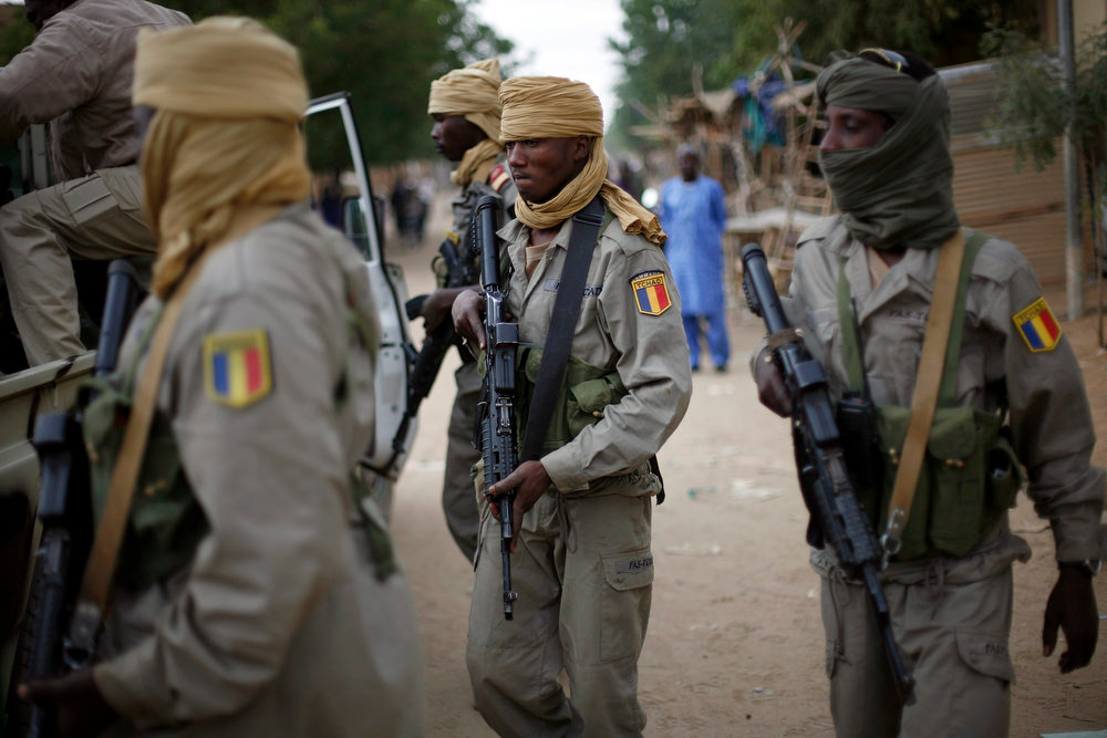 . Chadian soldiers patrol the streets of Gao, northern Mali, Monday, Jan. 28, 2013. After securing a strategic bridge and the airport in Gao on Sunday, Malian troops backed by French helicopters and paratroopers entered the fabled city of Timbuktu, north of Gao, on Monday after al-Qaida-linked militants fled into the desert. (AP Photo/Jerome Delay)
