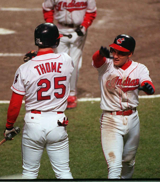 . Cleveland Indians\' Omar Vizquel, right, is greeted at the dugout by teammate Jim Thome after scoring in the third inning of Game Three of the World Series against the Atlanta Braves at Jacobs Field in Cleveland, Tuesday, Oct. 24, 1995.  (AP Photo/Al Behrman)
