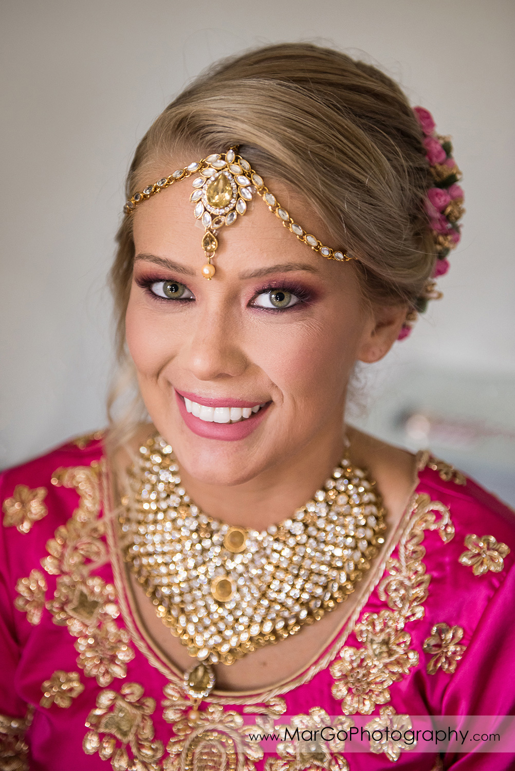 portrait of Indian bride in pink dress