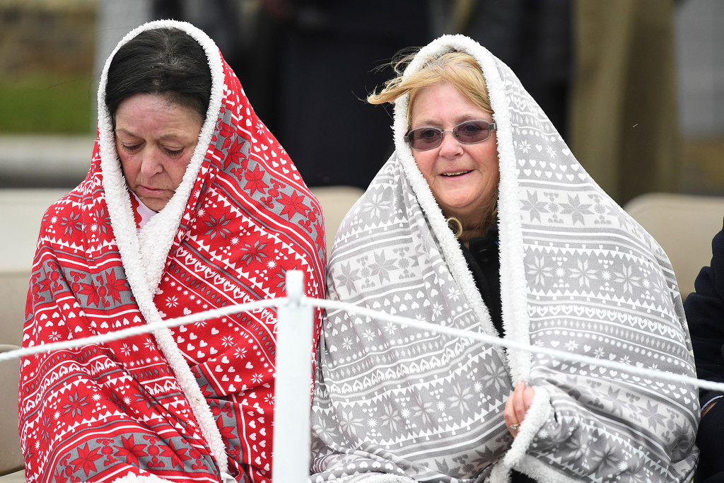 . People wear blankets as they wait to see Britain\'s Prince William and  Kate, the Duchess of Cambridge visit the 1st Battalion Irish Guards, for the St. Patrick\'s Day Parade, at Cavalry Barracks, in Hounslow, England, Saturday, March 17, 2018.  (Andrew Parsons/Pool Photo via AP)