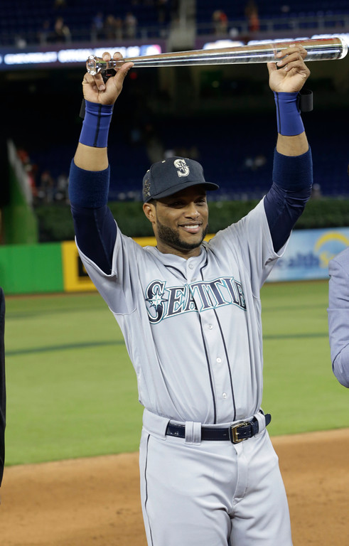 . American League\'s Seattle Mariners Robinson Cano (22), lifts the MLB All-Star MVP trophy, Tuesday, July 11, 2017, in Miami. Robinson hit the game winning home run in the tenth inning. The American League defeated the National League 2-1. (AP Photo/Lynne Sladky)