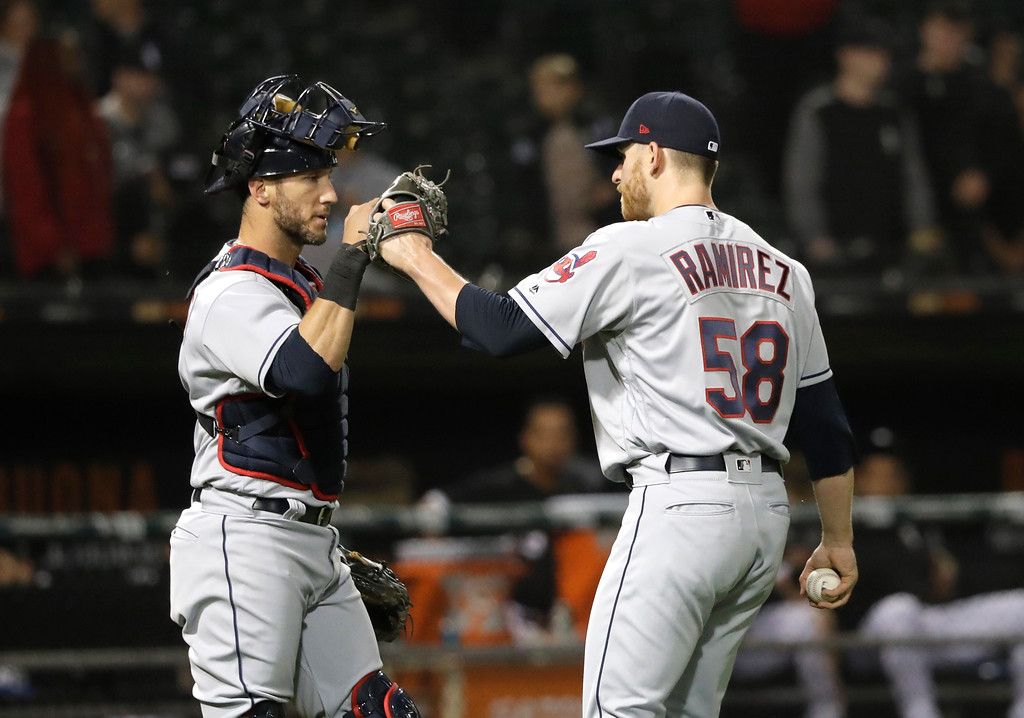. Cleveland Indians catcher Yan Gomes, left, and Neil Ramirez celebrate the team\'s 4-0 shutout of the Chicago White Sox after a baseball game Monday, June 11, 2018, in Chicago. (AP Photo/Charles Rex Arbogast)