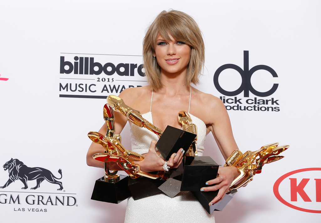 . Taylor Swift poses in the press room with the awards for top Billboard 200 album for �1989�, top female artist, chart achievement, top artist, top Billboard 200 artist, top hot 100 artist, top digital song artist, and top streaming song (video) for �Shake It Off� at the Billboard Music Awards at the MGM Grand Garden Arena on Sunday, May 17, 2015, in Las Vegas. (Photo by Eric Jamison/Invision/AP)