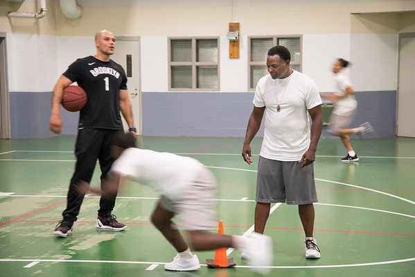 08/14/19 Wesley Bunnell | StaffrrThe Manson Youth Institution is implementing a basketball league, based off the New Britain Legacies Youth Development & Basketball Program, for inmates aged 14 to 21 to have a chance to play organized basketball with the qualification that inmates abide by the strict rules of the facility. Correctional officers and program coaches Derek Glasper, L, and Tim Thomas watch as inmates run through basketball drills. r