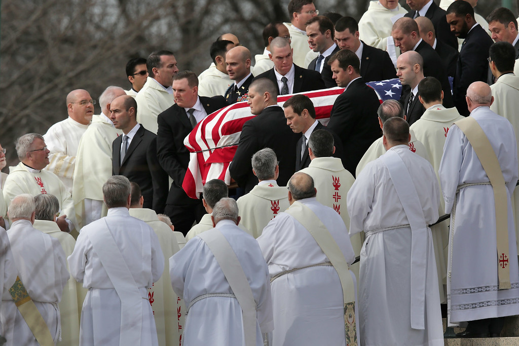 . U.S. Supreme Court Police pallbearers carry Associate Justice Antonin Scalia\'s flag-covered casket between rows of Catholic clergy and out of the Basilica of the National Shrine of the Immaculate Conception following his funeral February 20, 2016 in Washington, DC. Scalia, who died February 13 while on a hunting trip in Texas, laid in repose in the Great Hall of the Supreme Court on Friday and his funeral service will be at the basilica today.  (Photo by Chip Somodevilla/Getty Images)